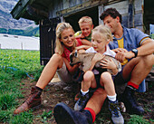 Family with a young goat, Eng, Kleiner Ahornboden, Tyrol, Austria