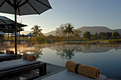 Pool at dust with view towards the golf course, Kirimaya Design Hotel, Thailand