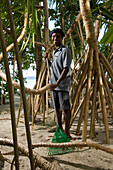 Man, gardener raking the sand, Luxury vacation on a private island with yacht, Rania Experience, Faafu Atoll, Maldives