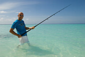 Man fishing in the lagoon, Luxury vacation on a private island with yacht, Rania Experience, Faafu Atoll, Maldives