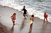 Children playing at beach, Calella de Palafrugell, Costa Brava, Catalonia, Spain