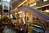 Young woman in shopping mall, Koenigsallee, Duesseldorf, North Rhine-Westphalia, Germany, Düsseldorf, North Rhine-Westphalia, Germany