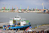 Ferry boat docks in Smiltyne, in the back the industrial harbour of Klaipeda, Lithuania