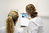 Dentists looking at an X-ray picture
