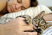 Cat sleeping with owner