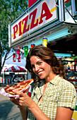 Woman at amusement park. County fair. Miami. Florida. USA