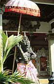 Art, Arts, Asia, Bali, Color, Colour, Daytime, Deities, Deity, Exterior, Figure, Figures, Holy, India, Outdoor, Outdoors, Outside, Parasol, Religion, Sculpture, Sculptures, Sunshade, Sunshades, Symbol, Symbols, Temple, Temples, Travel, Travels, Umbrella,