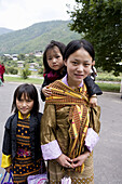 Young girl with sisters. Thimphu. Bhutan