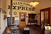 Wood stove and bank vault in the Wells Fargo and Co. Express office in Columbia. California. USA