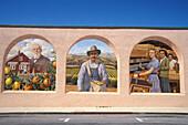Mural depicting citrus farm production titled Citrus capitol of the world by Don Gray. Santa Paula. California. USA