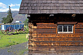 Pioneer cabins and Conestoga wagon at the Dalles Discovery Center. The Dalles. Oregon. USA