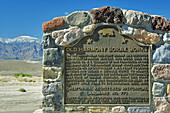 California historical landmark plaque under snow covered peak at Harmony Borax Works, Death Valley National Park, California