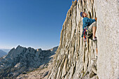 Climber leading up the north summit on Matthes Crest, Yosemite National Park, California