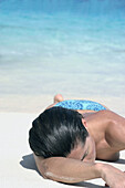 Adult, Adults, Beach, Beaches, Blue, Chill out, Chilling out, Clear, Color, Colour, Contemporary, Daytime, Exterior, Female, Heat, Holiday, Holidays, Human, Leisure, Limpid, Lying down, One, One person, Outdoor, Outdoors, Outside, People, Person, Persons