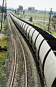 Transportation, loaded coal train. Energy, fossil fuel, greenhouse gases, global warming.