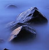 Rocks at waters edge. Hovs Hallar, Kattegatt Sea, Skåne, Sweden, Scandinavia, Europe.