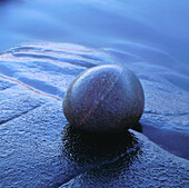Stone on rock at waters edge. Hovs Hallar, Kattegatt Sea, Skåne, Sweden, Scandinavia, Europe.