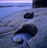 Cliffs with eroded holes from wind and ice. The Bohus Archipelago. Sweden.