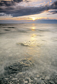 Lime stones at waters edge. Öland, Kalmar Sound, Sweden, Scandinavia, Europe.