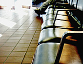 Adult, Adults, Alone, Anonymous, Chair, Chairs, Color, Colour, Comfort, Comfortable, Contemporary, Daytime, Detail, Details, Furniture, Horizontal, Human, Indoor, Indoors, Inside, Interior, Leg, Legs, Lined up, Lined-up, One, One person, People, Person,