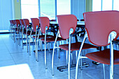 Arrangement, Business, Chair, Chairs, Classroom, Classrooms, Color, Colour, Concept, Concepts, Empty, Horizontal, Indoor, Indoors, Inside, Interior, Line, Lined up, Lined-up, Lines, Many, Nobody, Order, Perspective, Row, Rows, Seat, Seats, Table, Tables,