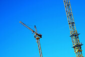 Blue, Blue sky, Color, Colour, Construction, Crane, Cranes, Daytime, Detail, Details, Economy, Engineering, Exterior, Height, Horizontal, Industrial, Industry, Outdoor, Outdoors, Outside, Pair, Skies, Sky, Tall, Two, G96-220075, agefotostock