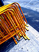 Color, Colour, Concept, Concepts, Construction, Construction site, Construction sites, Daytime, Detail, Details, Exterior, Fence, Fences, Industrial, Industry, Many, Metal, Obstacle, Obstacles, Orange, Outdoor, Outdoors, Outside, Pavement, Pavements, Sid