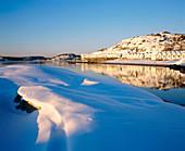 Beach huts in winter. Sweden
