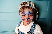 Amusement, Boy, Boys, Cap, Caps, Carefree, Cat, Cats, Caucasian, Caucasians, Child, Childhood, Children, Children only, Close up, Close-up, Closeup, Color, Colour, Contemporary, Cordial, Cordiality, Costume, Costumed, Costumes, Disguise, Disguises, Domes