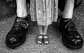 Amusing, B&W, Big, Black-and-White, Child, Childhood, Children, Compare, Comparing, Comparison, Comparisons, Concept, Concepts, Contemporary, Contrast, Contrasts, Detail, Details, Difference, Exterior, Feet, Female, Figure, Figures, Foot, Funny, Girl, Gi
