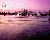Gondolas and San Giorgio Maggiore island in background. Venice. Italy