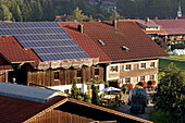 Farm with solar power plant on roof, Oberstaufen, Germany
