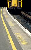 7 to 12 months, 7-12 months, Border, Caution, Color, Colour, Concept, Concepts, Daytime, Edge, England, Europe, Exterior, Great Britain, Horizontal, Mind the gap, Nobody, Outdoor, Outdoors, Outside, Platform, Platforms, Precaution, Railroad, Railroads, R