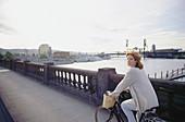 Woman touring across bridges at sunset. Portland. Oregon. USA