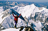Climber on the summit of Mount Khuiten (4.395 m.). Altai Mountains. Mongolia
