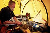 Cooking inside tent. Denali National Park. Alaska. USA