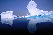 Progressor Kromov cruise vessel framed by iceberg. Petermann Island. Antarctica