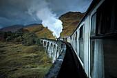 Passenger train crossing  West Highland Viaduct. Glenfinnan, Scotland
