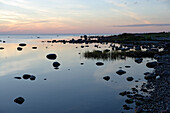 Water's edge at the coast of Loemala at sunset, island of Saaremaa, Estonia