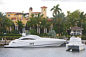 Yacht in front of villa at Sunset lake, Fort Lauderdale, Florida, USA