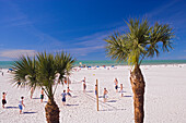 People playing beach volleyball under blue sky, Clearwater Beach, Tampa Bay, Florida, USA