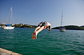 Mourtos, jumping off  the boardwalk of the marina
