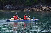 Two people kayaking along the coastline of Mourtos, Ionian Islands, Greece