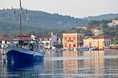 A boat leaving the harbour of Gaios, Paxos, Ionian Islands, Greece