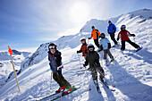 Children and adults skiing, skiing region Sonnenkopf, Vorarlberg, Austria