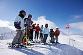 Children and adults on slope, Stuben, Arlberg, Tyrol, Austria