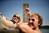 Young couple at a yetty at Lake Starnberg, Feldafing, Bavaria, Germany