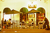 People at the terrace of Cafe Puerto Rico at night, San Juan, Puerto Rico, Carribean, America