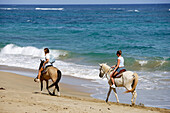 Two women riding along the beach, Aguadilla, Puerto Rico, Carribean, America