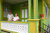 An elderly couple on their porch, San German, Puerto Rico, Carribean, America